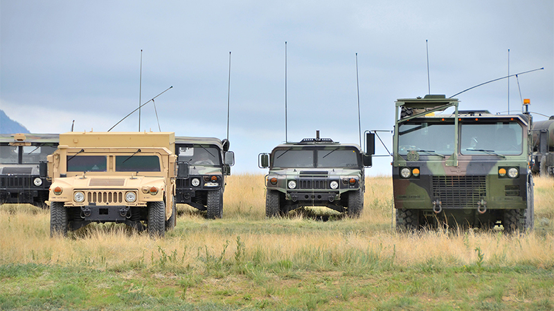 Military Convoy Showing Vehicle Antennas