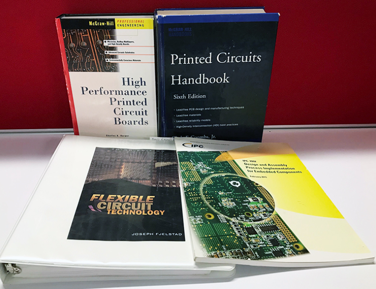 Assortment of publications related to PCB design and manufacturing